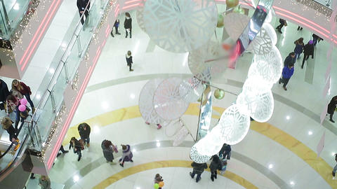 Many busy people rushing to buy Christmas presents, shopping mall atmosphere Footage