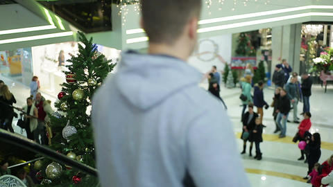 Atmosphere in shopping mall before winter holidays, people buying presents Footage