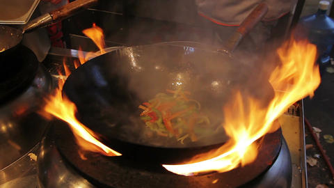 Amazing cooking skills. Cook frying vegetables at open fire. Asian food fest Footage