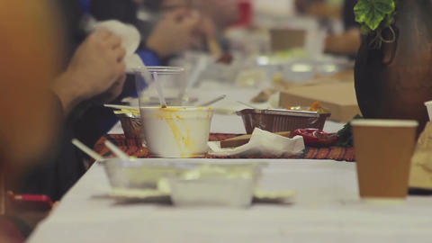 Charity banquet. People eating and enjoying delicious meals. Helping homeless Footage