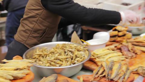 Crispy salty snacks. Street vendor selling fried seafood. Poor sanitation Footage