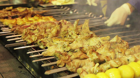 Juicy barbecue preparing on brazier. Street food festival. Appetizing meal Footage
