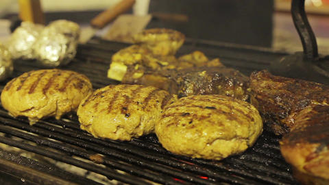 Barbecue on grill. Unhealthy fatty grilled meat. Cholesterol, obesity problems Live Action