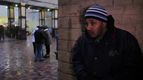 Drug dealer checks for goods and waiting for a buyer. Nervous criminal Footage