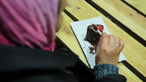 Health problems, diabetes, obesity. Woman eating brownie with strawberries Footage