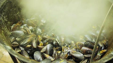 Seafood market. Mediterranean cuisine. Seaside resort. Selling fried mussels Footage
