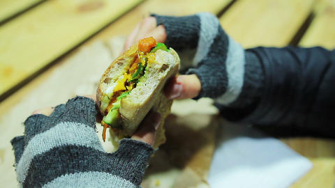 Poor and hungry student eating tasty sandwich with fish and vegetables Live Action