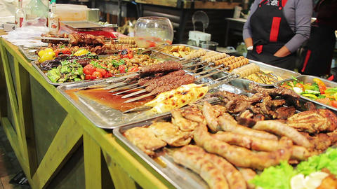 Fatty meat displayed at street shop. Unhealthy food, cholesterol, overweight Live Action