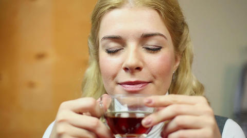 Positive smiling lady drinking hot black tea and looking charmingly into camera Footage