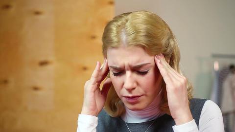 Blond woman having headache, nervous breakdown at work.… Stock Video Footage