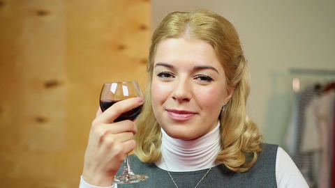 Pretty woman drinking red wine, flirting with her boyfriend in cafe, smiling Live Action