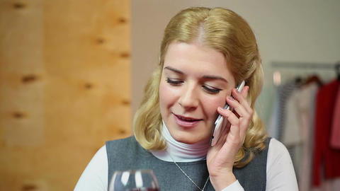 Girl talking on the phone and drinking red wine, conversation with beloved Footage
