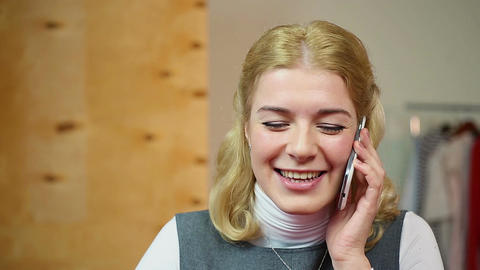 Happy woman talking with a friend on the mobile phone, having fun and smiling Footage