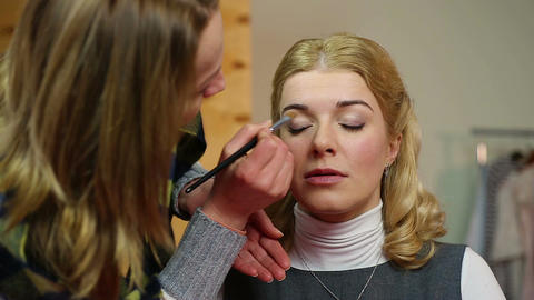 Skilled artist applying makeup, female news anchor getting ready for show Footage