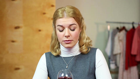 Drunk woman sitting at home and drinking red wine, alcohol addiction, loneliness Footage