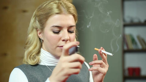 Business lady lighting a cigarette, smoking at working place, health problems Footage