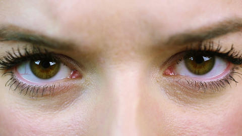 Angry woman screwing up her eyes, extreme close-up. Anxious, nervous person Footage