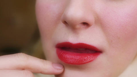 Woman seductively touching her face, flirting with someone. Sensual red lips Footage