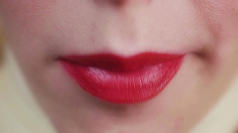 Closeup view of female mouth chewing gum. Woman with red lips and bad manners Footage