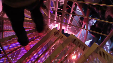 People walking down the stairs to the bar. Night club. Relaxation. Weekend Footage