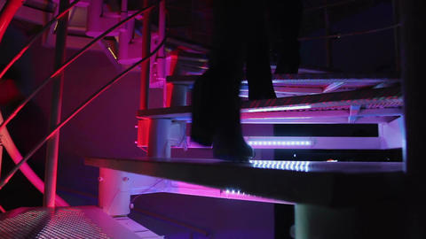 Beautiful people entering nightclub. Climbing stairway. Relaxation, enjoyment Footage