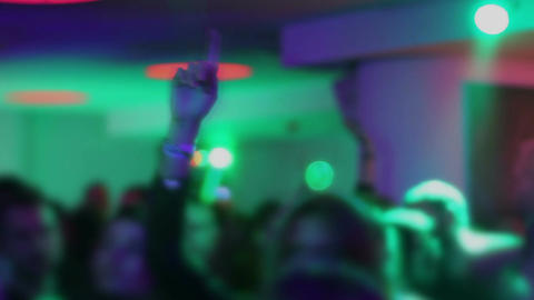 Happy people partying in the night club. Flashing lights. LED illumination Footage