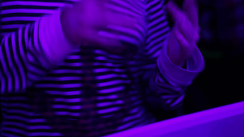 Female in striped blouse dancing at party. Night club atmosphere, relaxation Footage