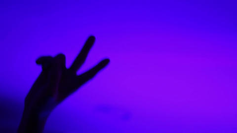 Drunk dancing man in the night club. Male raising hands up showing peace sign Footage