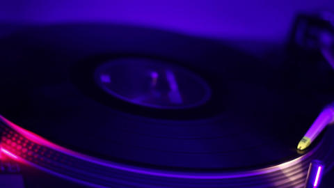 Vinyl record playing and turning around. Night club atmosphere. Audio equipment Footage