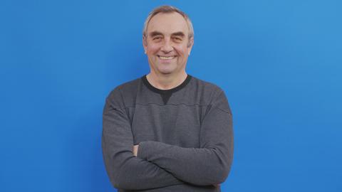 Portrait of emotional senior man smiling. Closeup mature man with positive Live Action