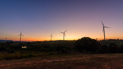 wind turbines park for make the electric power from wind in sunset time Live Action