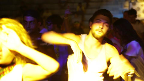 A man in a disco at night. Party. Dance floor. Festival. Joy Live Action