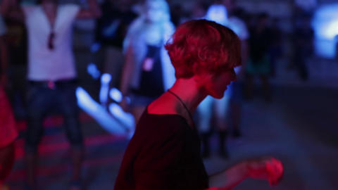 Girl at the disco at night. Party. Dance floor. Festival. Joy Live Action