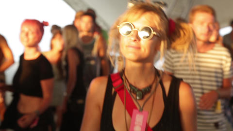 The girl is dancing on the dance floor in a disco. Festival. Joy Live Action