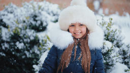 Attractive Girl In a Winter Snowy Day Footage