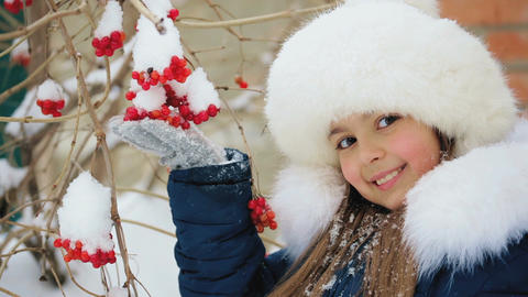 Girl Holds a Bunch of Viburnum Outdoors in Winter Footage
