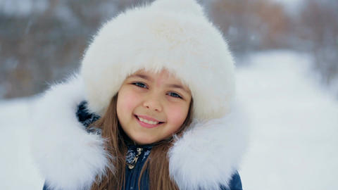 Girl in White Furry Hat on a Winter Day Stock Video Footage