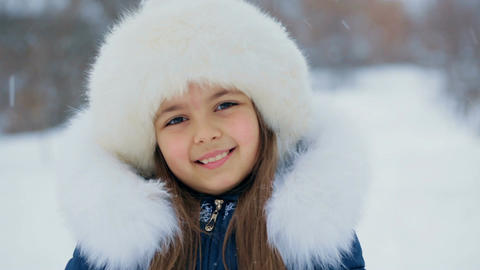 Girl in White Furry Hat on a Winter Day Footage