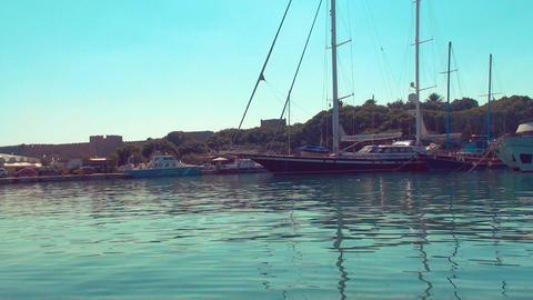 Boat tracking shot of yachts and sailboats at the Rhodes marina Footage