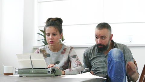 Man and woman at work having strong emotions Live Action