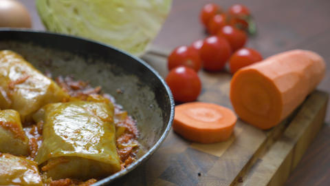Cabbage rolls with meat, rice and vegetables Live Action