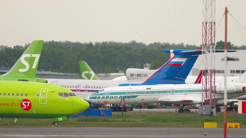 S7 Airlines Boeing 737 airliner taxiing to runway for departure Live Action