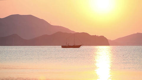 Sailing boat in the sea at sunrise Stock Video Footage