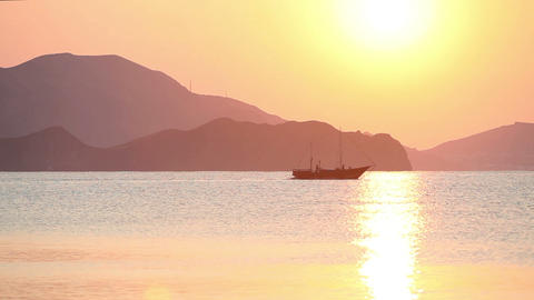 Sailing boat in the sea at sunrise Footage