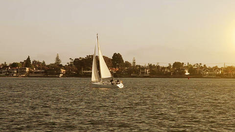 Sailing boat in the sea at sunset Footage