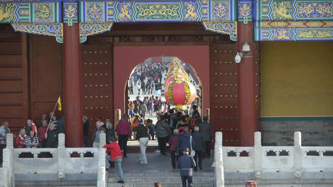 Tourists visitors at red door,Chinese red lanterns.China's ancient architecture Footage