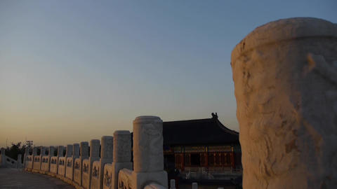 Long white stone jade railing at sunset.China ancient architecture temple Footage