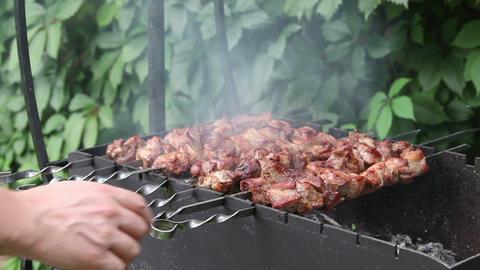 Man prepares pork shashlik on skewers Stock Video Footage