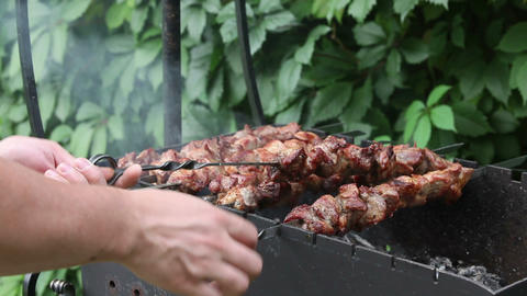 Man prepares pork shashlik on skewers Footage