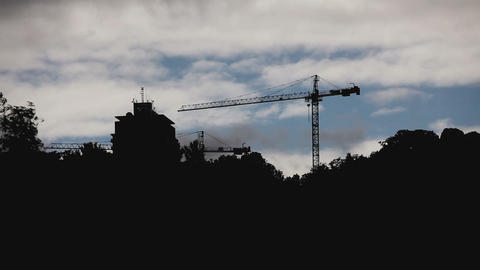 Crane and building silhouette with cloudy sky timelapse Stock Video Footage